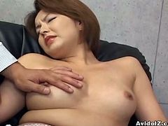 This hot Japanese babe gets down and dirty with two guys in a threesome.She sucks each of them in turn before allowing them both a go inside her tight wet pussy.