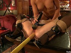 Tied up brunette chick gets her ass toyed by her master. After that she gets her pussy and ass stuffed deep at the same time.