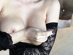 Blonde stunner is wearing lacy black dress that traces tempting curves of her body. She then takes off her sexy dress teasingly.