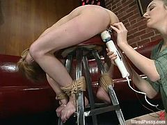 Alex Divine is getting naughty with her dominant GF in a hot BDSM scene. She lets the mistress tie her up and attach wires to her tits and then gets her snatch pounded with a strapon.