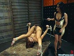Naughty Asian girl gets chained by her mistress. Then she gets her pussy toyed with a vibrator and an electric dildo. She also gets hit with electricity and fucked with a strap-on from behind.