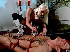Lewd blonde Lorelei Lee is having BDSM fun with Steve Sterling. The mistress binds and torments her slave and then pulls him by the nuts and plays with his schlong.