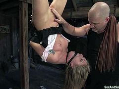 Amazing blonde cutie Jaelyn Fox is getting naughty with Mark Davis in a basement. Mark binds and hangs Jaelyn up and then pokes his manhood into the girl's mouth and sweet pussy.