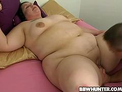 Fat brunette woman gives a blowjob and then lies down on a bed. A guy licks her pussy and then fucks the BBW as hard as he can.