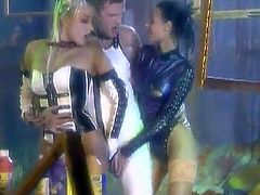 Stunning chicks in stockings and latex lick and toy each others wet pussies. The also get rammed by a big cocked guy on a table.
