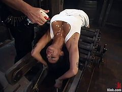 Adorable brunette girl gets undressed and oiled up. After that she also gets tied up and face fucked. Later on she gets fucked hard from behind.