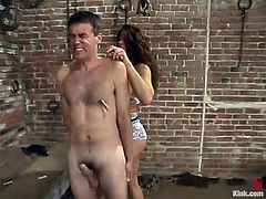 Sexy hussy Kym Wilde is having fun with submissive Wild Bill indoors. She binds the guy and tortures him and then plays with his wang and fucks his ass with a strapon.
