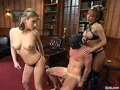 Guy in mask toys mistress' pussy and gets whipped