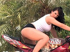 Brunette Aria Giovanni shows off her big boobs in wild outdoor solo session