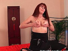 Courtesy of Older Woman Fun you can see how a vicious redhead milf gets her cunt banged deep and hard into a massive orgasm in this nasty free porn video.
