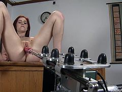 Sexy redhead chick Cameron Love is having some good time in a classroom. She pets herself ardently and then gets her vag pounded hard by a fucking machine.
