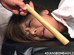 Whether it be a screwdriver, wrench or a hammer, it doesn't matter. This girl is going to be tortured with all of them. She is tied to a table with rope and her ass, is stuck in the air. Her masters rub the tools on her face, before fucking her with them.
