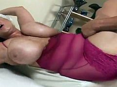 Huge-boobed blonde mom Samantha 38G is having fun with some guy indoors. She titfucks his prick, then sucks it ardently and takes it deep into her throbbing cunt.