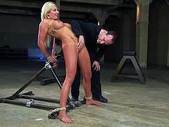 Sexy curvy blonde milf Skylar Price gets shackled in a basement. Then some guy toys her shaved pussy and makes her moan loudly with pleasure.