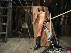 Sexy dark-haired chick Jasmine Byrne is having fun in a basement. She lies down on the ground and moves her legs wide apart and gets her twat drilled hard by a fucking machine.