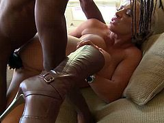Big-breasted blonde milf Carmen Jay sucks and rubs a black sausage and gets horny. Then she sits down on the BBC and gets her coochie pounded like never before.