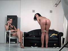 Curvaceous brunette chick takes her yellow lingerie off in front of Silvia Saint. Then she shakes her booty and fondles the pussy lying on a sofa.