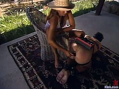 Slutty dominatrix Isis Love is having fun with a dude called Rok outdoors. She plays with his dick and rides it and then humiliates the man in many ways.