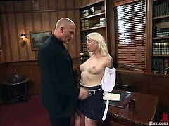 Naughty blonde girl gets undressed and bounded right in the office. She blows two big dicks and then gets spanked. After that she double penetrated.