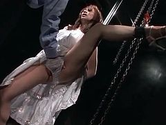 Bound Japanese girl in sexy dress finger fucked