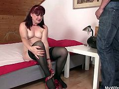 Check out this horny mature caught by her son in law with her favorite toy. She sticked it into her pussy and he decided to help her out with his young stiff cock!