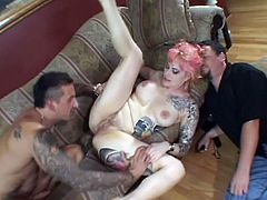 Take a look at this hardcore scene where this busty tattooed hottie's fucked by a horny guy until swallowing his load while her man watches up close.