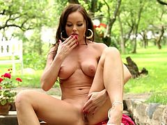 Gorgeous brown-haired MILF takes her clothes off to show her sexy body. She looks much hotter than younger girls. She licks her fingers and then masturbates.