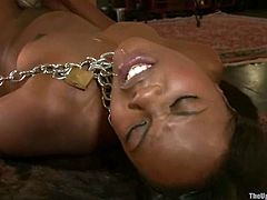 Cute ebony girl Coffee Brown is having fun with some dude indoors. She lets the man put her into irons and then enjoys having his big dick in her mouth.