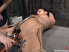 It's Princess Donna Dolore's turn to get punished. She gets tied up by some blonde and then gets pulled by the pussy lips and fucked with some iron things.