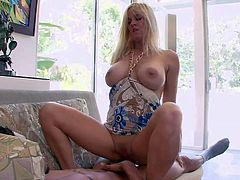 Totally Tabitha is a good looking mature blonde babe with big tits. This lovely milf with nice heavy melons gets her pussy drilled and then takes internal cumshot. She poses with legs apart after hard sex with creampie.