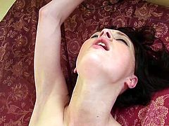 Pretty brunette babe in glasses sucks big fat cock sitting on bed. Then she turns around and gets fucked from behind in POV video.