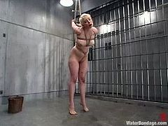 Insatiable blonde Lorelei Lee loves it rough. She gets bound in a jail by Sgt. Major and enjoys giving him a deepthroat blowjob and being drowned.