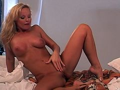 Sexy blonde milf Silvia Saint shows off her amazing vagina. She spreads her legs and plays with her pussy. Watch as she sticks her fingers inside her vagina. She really likes playing with herself and she likes you watching her.