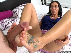 Bitch got two swallows tattooed, one in each foot, but does she swallow? Not in this video, she just gives a footjob.