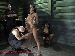 Hot brunette babe is buck naked and held captive. She's tied up, she can't move and she's about to go through a hardcore and merciless BDSM punishment.