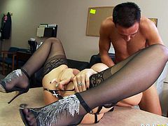 Dirty wench with fine body shape is lying on a table getting her pussy licked upskirt. She then gets penetrated in her pussy hole in a missionary position. Steamy office fuck scene presented by Brazzers Network.