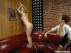 Cloe Hartis playing dirty games with redhead dominatrix Sonya. She lets Sonya spank her ass and then the mistress drills Cloe's vag with a strapon.