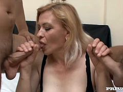 Hussy blonde bitch is a pro slut who is ready to serve all dudes around. She guzzles two dicks and dreams of cum load deep in her throat.