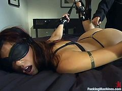 Lovely brunette in black lingerie gets tied up and blindfolded in her bedroom. Then she gets her wet pussy toyed by the fucking machine.