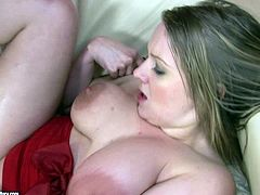 Luscious MILF with appetizing big boobs squeezes hard dong between her twins. She gives the guy awesome titjob. Later on she is poked deep in her wet pussy in a missionary position upskirt.