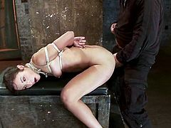 This submissive girl gets dominated by a girl and a guy. She gets tied up and then face fucked. Later on she gets her ass and pussy toyed by Isis Love.