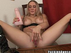 First she sucks on this great big dildo and then she shoves it into her cute pussy hole. She rubs it in between her perfect soft and supple boobies. She sucks the pussy juice off of the dildo like the dirty fucking slut that she is.