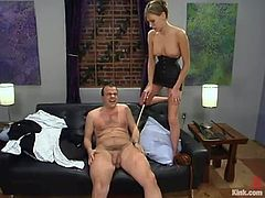 Lustful dominant milf Audrey Leigh is having fun with a guy called Bigdick in the living room. She attaches leads to his balls and then makes him suck her strapon before she drives it in his butt.