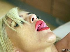 This sex-starved sexpot looks very tempting in her sexy black stockings. Buxom nympho knows that she is drivng her lover crazy and goes straight for his rock hard cock. She takes it in her lustful mouth and sucks it greedily like a super qualified slut.