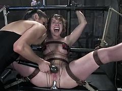 All sort of kinky action goes on in this BDSM lesbian clip where one of the girls is going through bondage and toying torture.