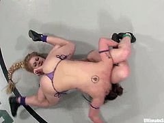 Brunette and blonde chicks wrestle in Ultimate Surrender competition. Tawni Ryden loses in the result of a tight fight. So, she licks Devi's pussy and gets toyed rough.