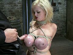 Submissive Katie Kox gets tied up by her Master. After that she gives him a blowjob standing on her knees.
