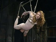 Nasty redhead girl gets tied up and gagged. Later on she gets her pussy and tits clothespinned. This girl also gets suspended and toyed with a stick.