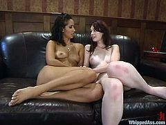Submissive Justine Joli strips her clothes off in the office and gets whipped. After that she licks Isis' vagina and gets toyed with a strap-on.