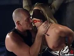 Naughty blonde girl gets blindfolded and tied up. After that she gets fucked in her mouth and vagina by Mark Davis.